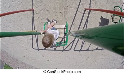 Beautiful little girl on the swing