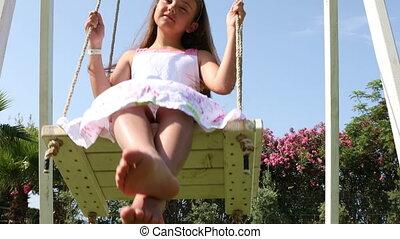 Beautiful little girl on the swings - Beautiful little girl...