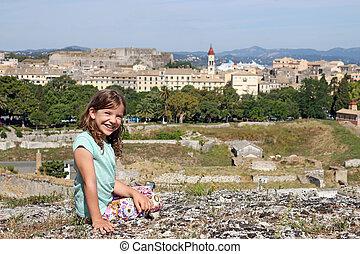 beautiful little girl on vacation Corfu town Greece