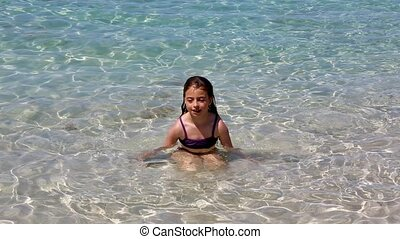 beautiful little girl playing beach