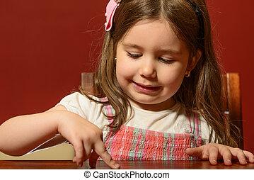Beautiful little girl playing
