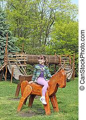 beautiful little girl playing on playground