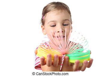 beautiful little girl playing with colorful plastic spring isolated on white