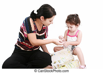 Beautiful little girl playing with her mother on the floor