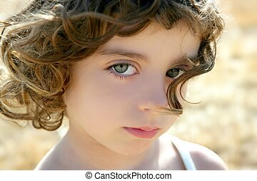 Beautiful little girl portrait outdoors
