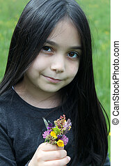 Beautiful little girl posing for session with flower bouquet