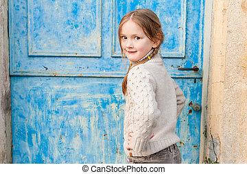 Beautiful little girl posing outdoor