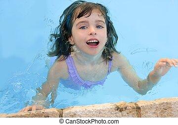 beautiful little girl smiling in pool