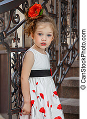 beautiful little girl with a flower in her hair