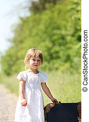 beautiful little girl with a suitcase