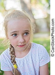 Beautiful little girl with big eyes outdoors