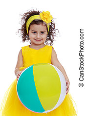 Beautiful little girl with curly dark hair holds up a big bouncy