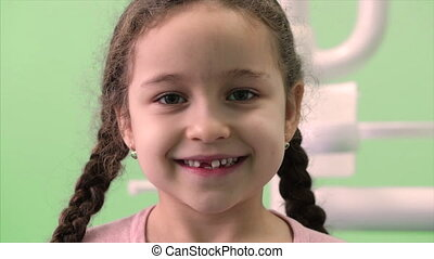 Beautiful Little Girl With Curly Hair and Two Pigtails in ...
