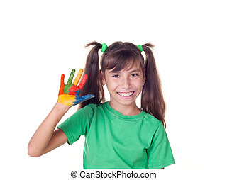 Beautiful little girl with hand in the paint