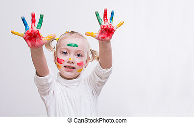 girl with hands in the paint