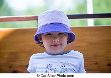 Beautiful little girl with hat
