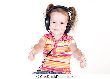 Beautiful little girl with headphones showing thumbs up
