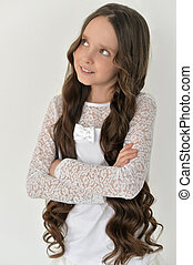 beautiful little girl with long hair
