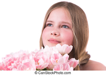 Beautiful little girl with pink tulips