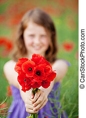 Beautiful little girl with red poppies