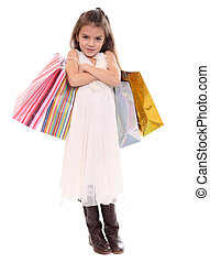 Beautiful little girl with shopping bags