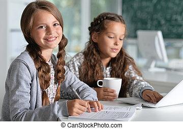 beautiful little girls at class - Portrait of two beautiful...