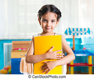 Beautiful little latin girl portrait in daycare - Beautiful...