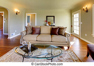Green walls, beige tones and cozy craftsman style living room.