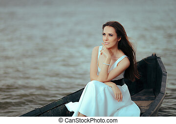 Beautiful Lonely Woman in Old Fishing Boat Floating on Sea