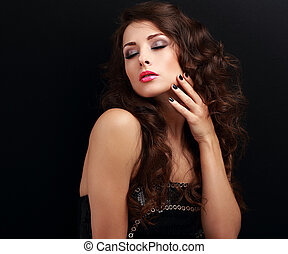 Beautiful long curly hair woman with closed makeup eyes and manicured nails