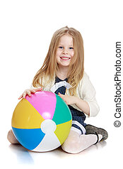 Beautiful long-haired blonde girl with a big ball in his hands