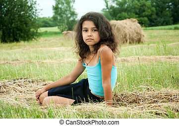 Beautiful long-haired girl in a field
