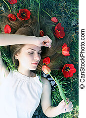 romantic girl with a bouquet of tulips