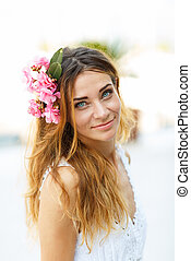 Beautiful lovely woman with flower hair accessory