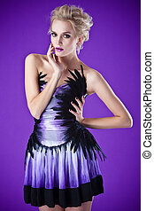 beautiful luxurious woman on purple background