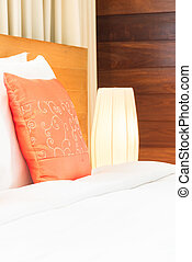 Beautiful luxury bedroom interior with orange pillow decoration in hotel resort