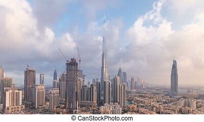 Beautiful luxury Dubai downtown aerial top view at sunset...