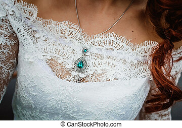 pendent on the bride