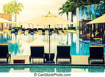 Beautiful Luxury Swimming pool with umbrella and chair in hotel resort
