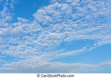 Beautiful mackerel sky with many small white clouds