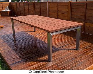Beautiful mahogany hardwood deck floor and table