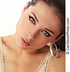 Beautiful make up woman face with attractive green eyes with black eyeliner looking sexy. Closeup portrait