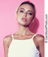 Beautiful makeup blond woman with clean skin and elegant neck posing in white top on pink background. Closeup sensuality portrait