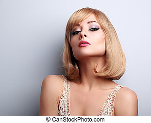 Beautiful makeup blonde woman with short hair style posing