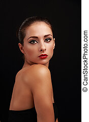 Beautiful makeup female model with red bright lips on black