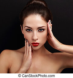 Beautiful makeup woman with bright red lips looking sexy.