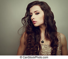 Beautiful makeup woman with curly long hair. Closeup vintage portrait