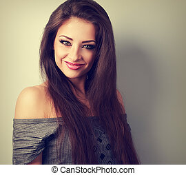 Beautiful makeup woman with long brown hair looking happy? Toned closeup portrait