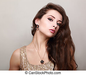 Beautiful makeup woman with long brown hair. Portrait