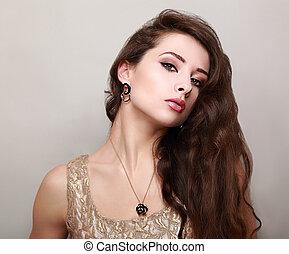 Beautiful makeup woman with long brown hair